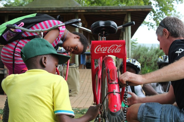 Putting a chain back on the Coca-Cola bicycle