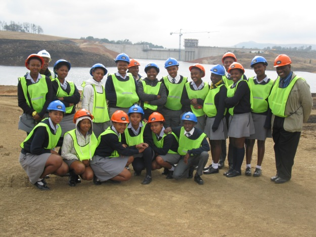 Group photo with dam