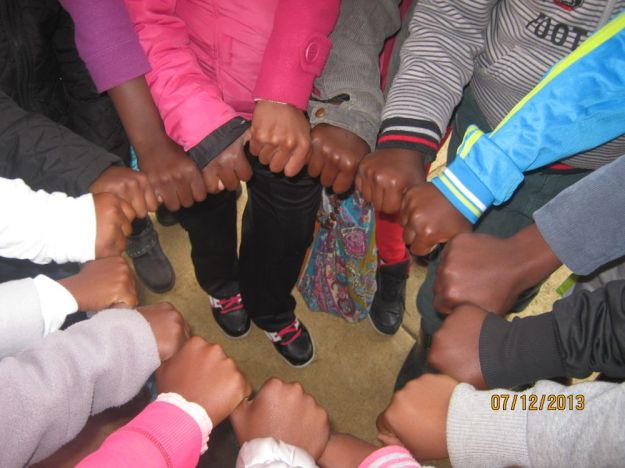 mpop kidz holding thumbs