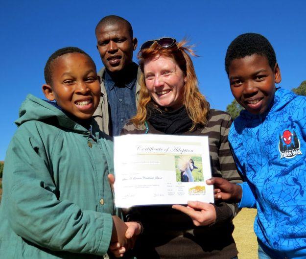 r Welile duda, Nicholas Nxumalo and Samkelo Sikhosana receive Boston adoption certificate from Nicky Willmers