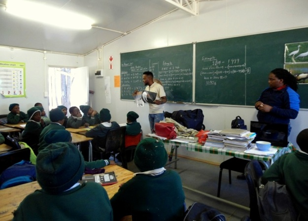 Nkanyiso is super dynamic in the classroom and uses pictures to show the learners what our African cranes look like